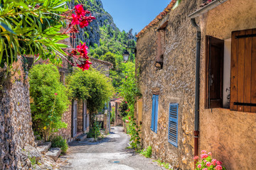 Fototapeta Moustiers Sainte Marie village with street in Provence, France