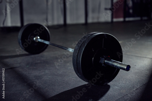Closeup of barbell on gym floor Canvas Print