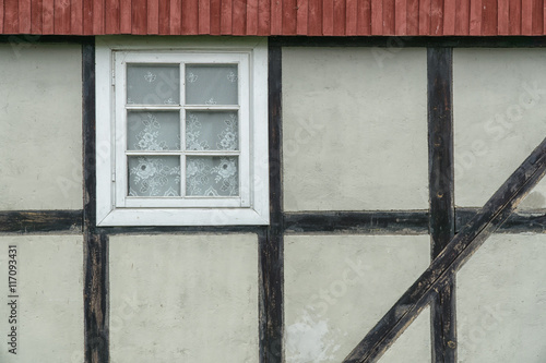 Fotografie, Obraz  Timber frame wall with window and red roof