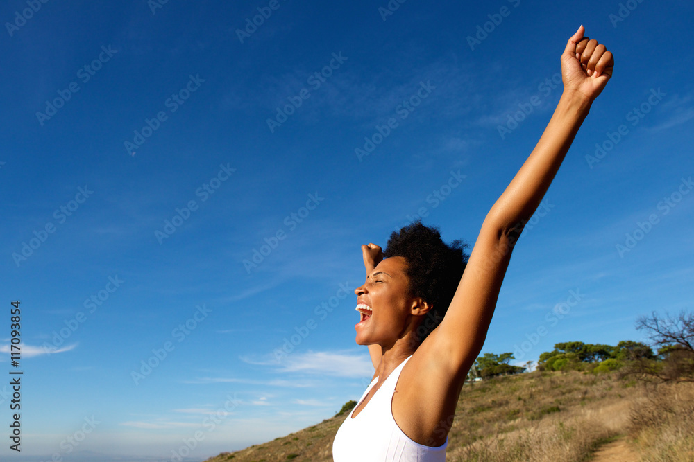 Fototapety, obrazy: Overjoyed fit woman standing outdoors