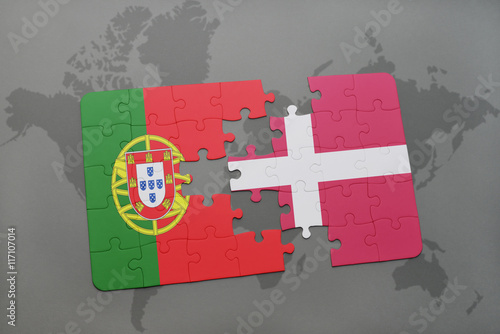puzzle with the national flag of portugal and denmark on a world map background Poster