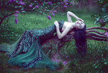 Pretty Slim Girl With Dark Hair In A Long Emerald Green Dress Wi