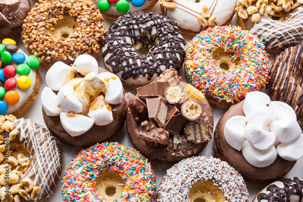 Fototapety, obrazy: Close up of a selection of colorful donuts.