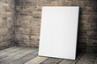 canvas print picture - Blank white canvas frame leaning at grunge brick wall and wood f