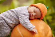 Baby With Pumpkin Hat Sleeping...