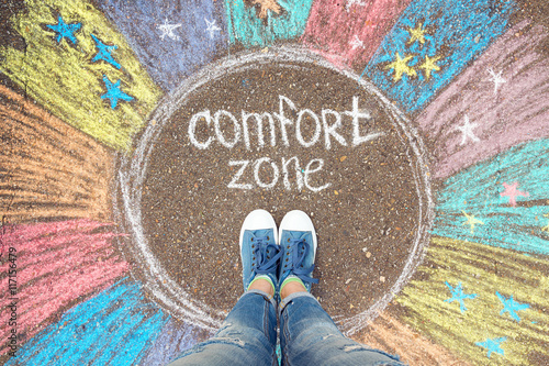Obraz na plátne Comfort zone concept. Feet standing inside comfort zone circle.
