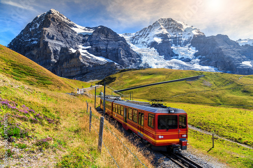Fototapeta  Electric tourist train and Eiger North face,Bernese Oberland,Switzerland
