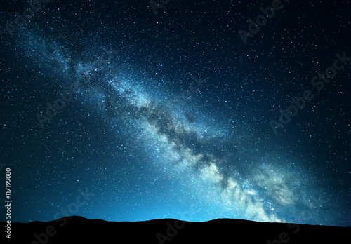 Garden Poster Black Night landscape with amazing Milky Way at mountains. Blue night starry sky with hills at summer. Beautiful Galaxy. Universe. Space background