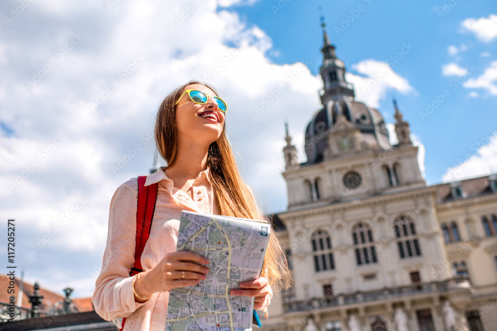 Fototapety, obrazy: Young woman traveling with map in the central square in Graz old town. Traveling in Austria