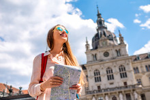 Young Woman Traveling With Map In The Central Square In Graz Old Town. Traveling In Austria