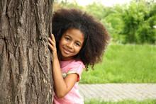Afro-American Little Girl Hidi...