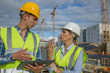 business, building, paperwork and people concept - builder in hardhat with tablett outdoors