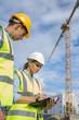 Portrait of builder works at construction site