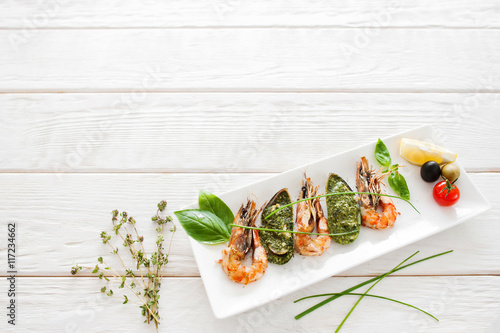 Fotografía  Delicious seafood mix on white wooden background, copyspace