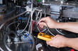 skilled worker while fixing a bottling plant during maintenance work