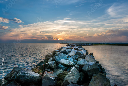 Sunset over a rock jetty on the Chesapeake Bay Wallpaper Mural