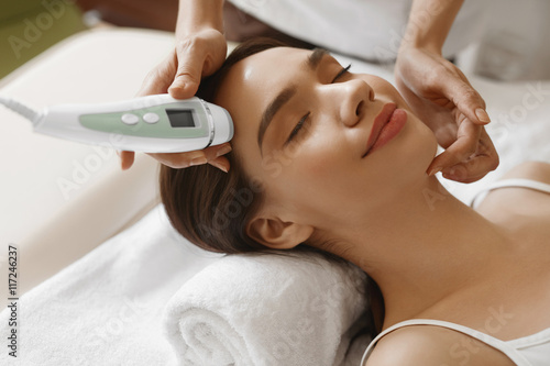 Skin Care. Women Analyzing Facial Skin With Analyzer. Beauty Wallpaper Mural