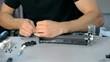 Mid shot Worker repairs electronic stuff