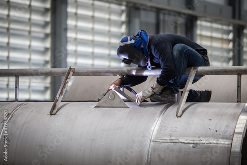 Fotografie, Obraz  close up of technician welding metal pipe with argon,focus flash