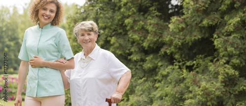 Elderly with walking stick Canvas Print