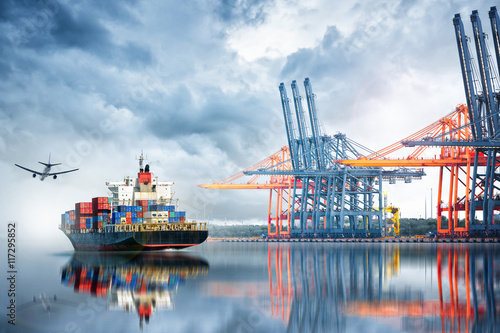 Photo  Container Cargo ship and Cargo plane with working crane bridge in seaport , logistic import export background and transport industry