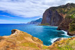 View of beautiful mountains and ocean on northern coast near Guindaste, Faial, Portugal
