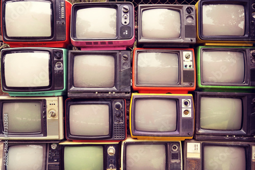 Photo sur Toile Retro Pattern wall of pile colorful retro television (TV) - vintage filter effect style.