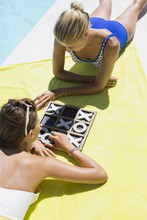 Female Friends Playing Tic-tac-toe At The Poolside