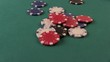Poker Chips Falling Down on The Poker Table