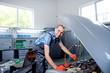Auto mechanic worker in garage.