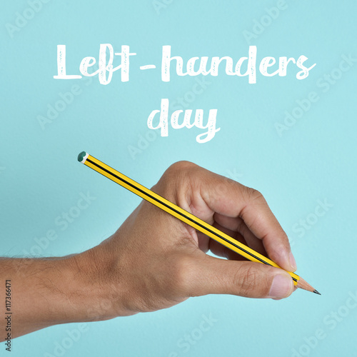 text left-handers day and the hand of a lefty Wall mural