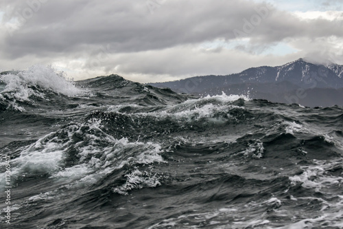 Canvas Prints Dragons storm surge on the background of the Northern mountains