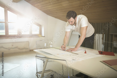 Architect making a blueprint in the office, Bavaria, Germany Wallpaper Mural