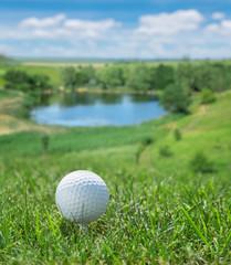 Panel Szklany Podświetlane Golf Golf ball ready to be hit on the green grass.