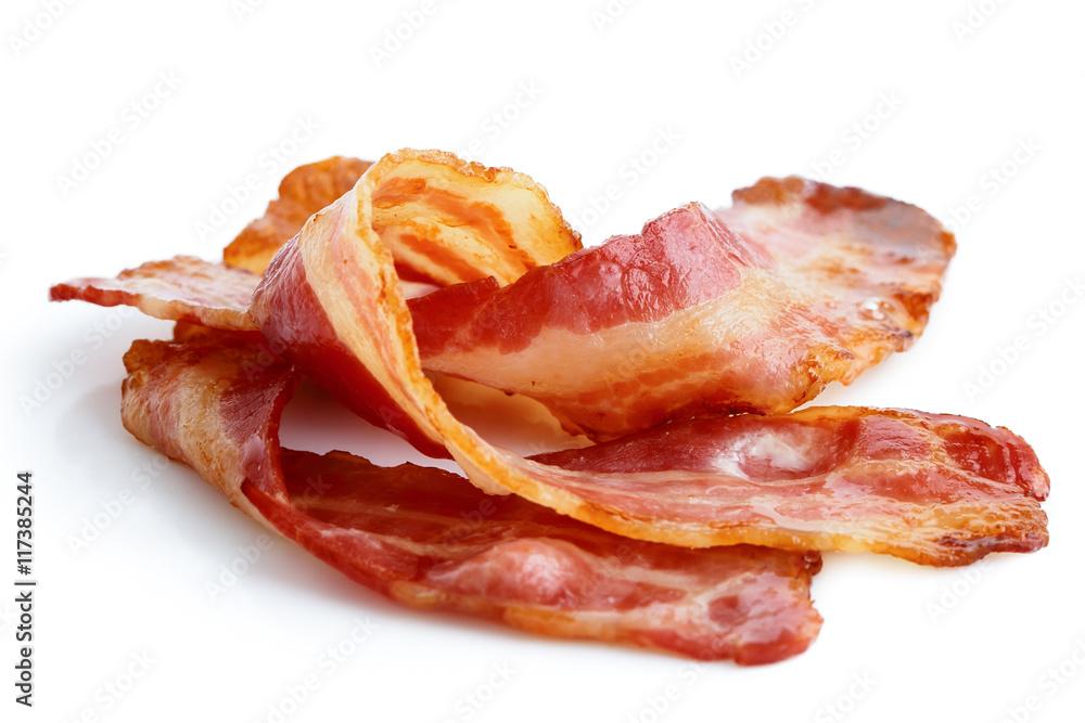 Fototapeta Three strips of fried crispy bacon isolated on white.