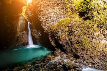 Fototapeta na wymiar Kozjak waterfall in Triglav natioanl park in Slovenia. Long exposure technic with motion blurred water