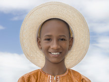 Smiling Boy Wearing A Boater Straw Hat