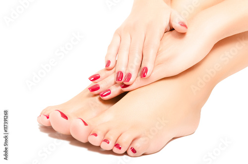Spoed Foto op Canvas Pedicure Beautiful foot and hands with red manicure