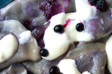 Polish Dumplings With Blueberries. Decorated With Strawberries.