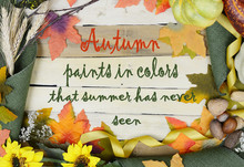 Cheerful Fall Or Autumn Border With Fall Leaves, Nuts, Sunflowers And Squashes With Green Folded Burlap And Gold Ribbon On A Wooden Background.  Colors Also Include Orange And Yellow. Fall Message.