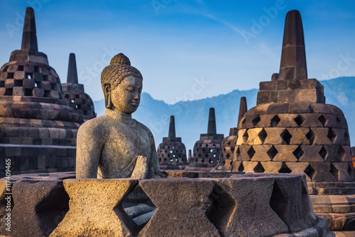 Ancient Buddha statue and stupa at Borobudur temple in Yogyakart