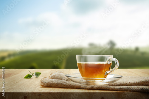 Photo sur Toile The Tea cup with and tea leaf sacking on the wooden table and the te