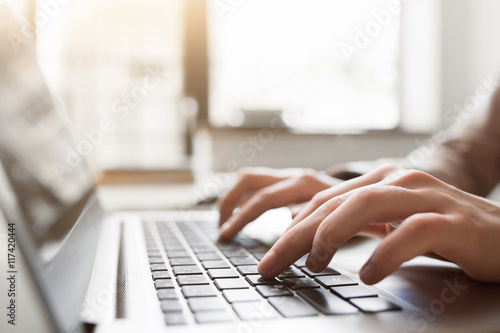Fotografie, Obraz  Typing on laptop closeup, chatting in Facebook, meeting website