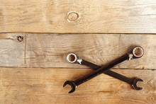 Wrenches On The Wooden Background.