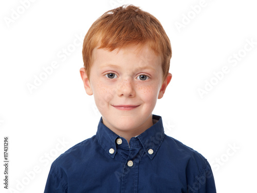 Fotografía  Close up face of a smiling ginger boy isolated on white background
