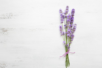 Bundle of lavender on old wooden board painted white.