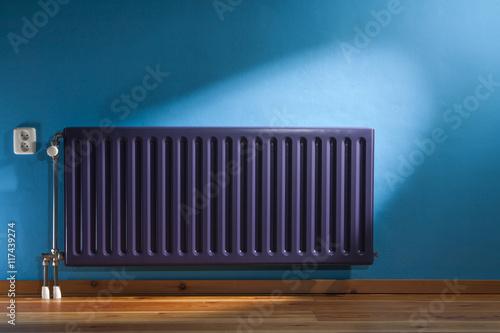 Fotografie, Obraz  Purple radiator and a blue wall