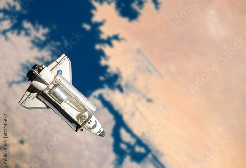 Deurstickers Nasa Space Shuttle orbiting the earth. Elements of this image furnish