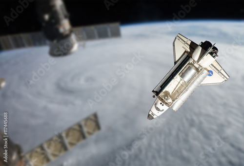 Tuinposter Nasa Space Shuttle orbiting the earth. Elements of this image furnish