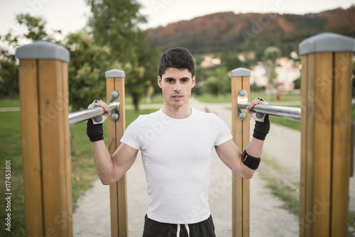 Portrait of a young man, ready to train on a metall bars
